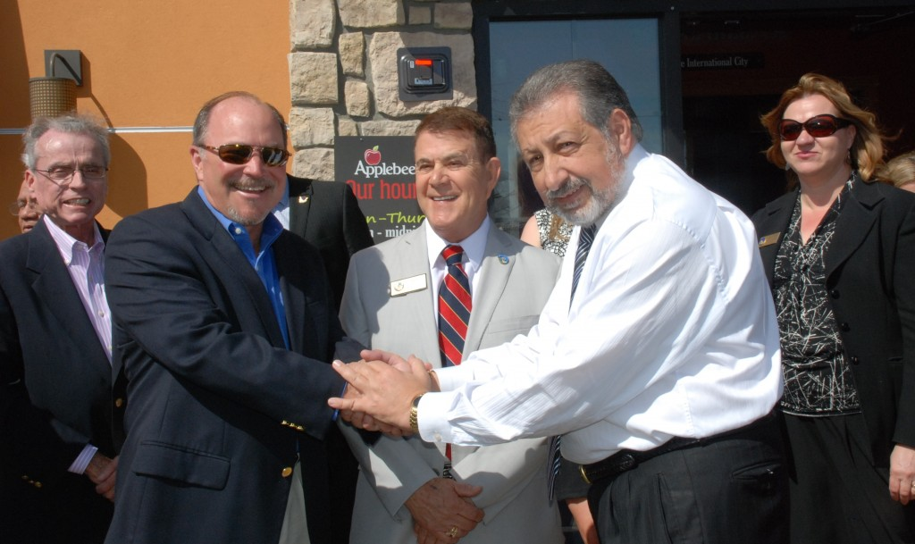 David Slater, Vice President and COO of Signal Hill Petroleum, Signal Hill Mayor, Michael J. Noll, and Joseph Abraham, General Manager of the Signal Hill Applebee's